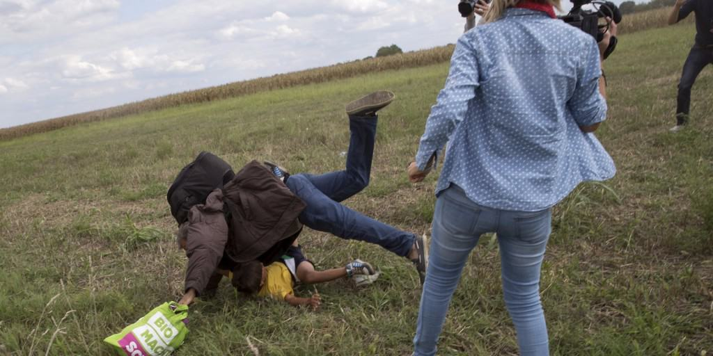Hungarian Camerawoman Caught Kicking And Tripping Refugees